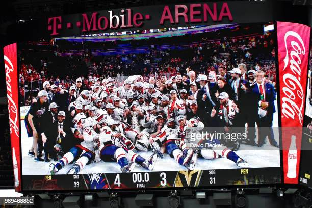 Video of the Washington Capitals posing for a photo with the Stanley Cup is shown on the scoreboard after Game Five of the Stanley Cup Final against...