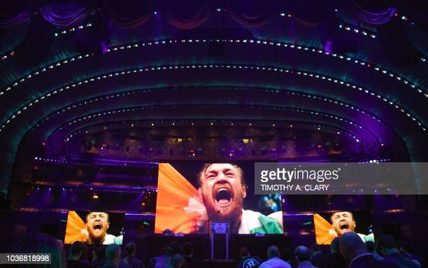 Video on the screen shows two-division UFC champion Conor McGregor of Ireland before the start of a press conference at Radio City Music Hall in New...