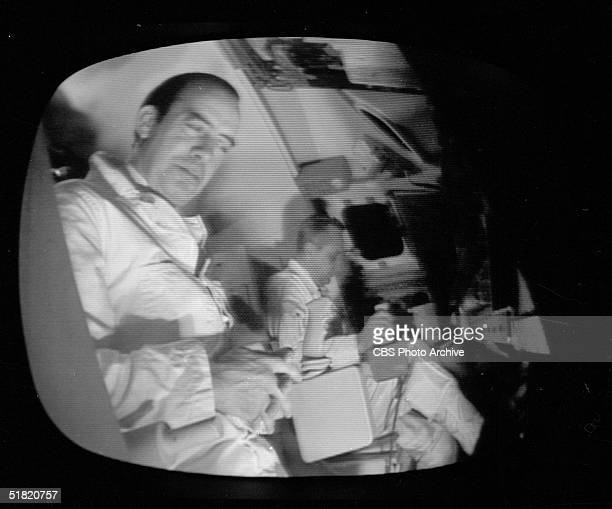 Video screen grab of American broadcast journalist Bill Stout reporting from inside a fullscale mockup of the Command Service Module during 'The...