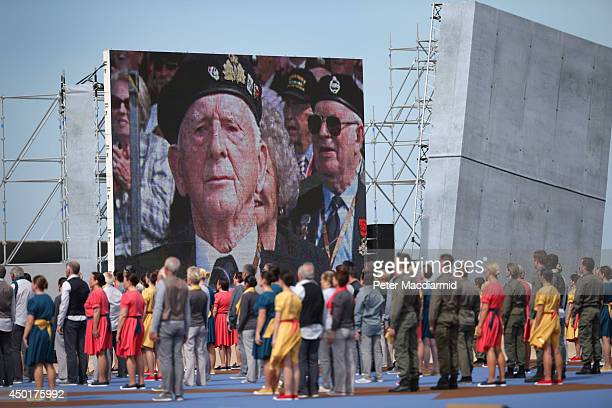 A video screen shows images of veterans during the International Ceremony at Sword Beach to commemorate the 70th anniversary of the DDay Invasion on...