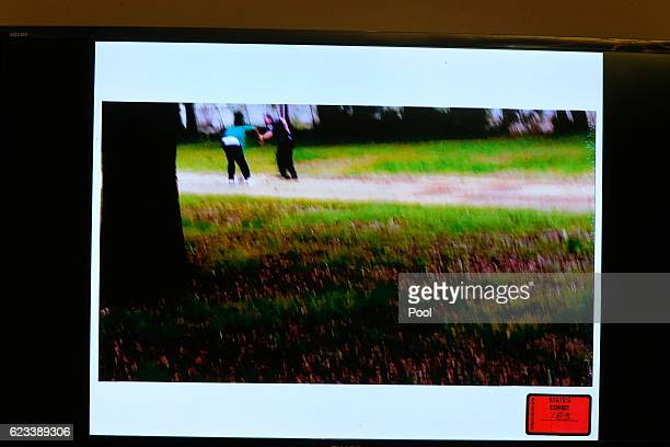 Video showing former North Charleston police officer, Michael Slager holding Walter Scott, is shown in court during his Slager's murder trial in...