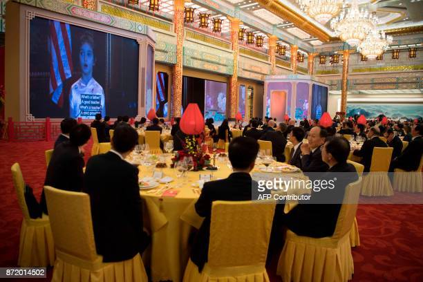 TOPSHOT A video showing US President Donald Trump's granddaughter Arabella Kushner singing is broadcast during a state dinner hosted by China's...