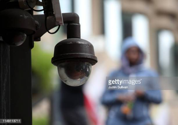 A video surveillance camera hangs from the side of a building on May 14 2019 in San Francisco California San Francisco could be the first city in the...