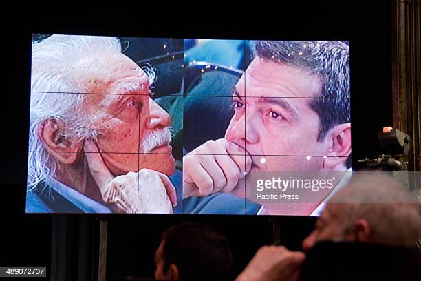 A video wall the showing of Manolis Glezos and Alexis Tsipras