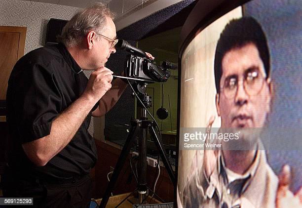 Videocamera in hand Father Dan Harris records student Jose Luis Muro giving a sermon during a class at St John's Seminary in Camarillo Father Harris...