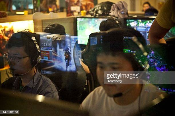 Videogame enthusiasts play 'League of Legends' during the 'PC Bang Tournament' organized by Riot Games Inc's Korea unit at Lion Internet Cafe in...