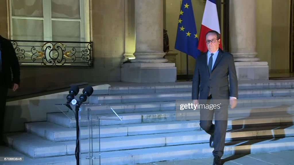 A videograb made on April 21, 2017 shows French President Francois Hollande arriving to make a statment at the Elysee Palace in Paris after a shooting on the Champs Elysees. One police officer was killed and another wounded today in a shooting on Paris's Champs Elysees, police said just days ahead of France's presidential election. Hollande said that a shooting on the Champs Elysees on Thursday evening was suspected to be 'of a terrorist nature.' /
