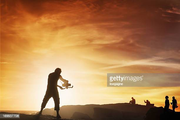 videographer at sunset - cinematographer stock pictures, royalty-free photos & images