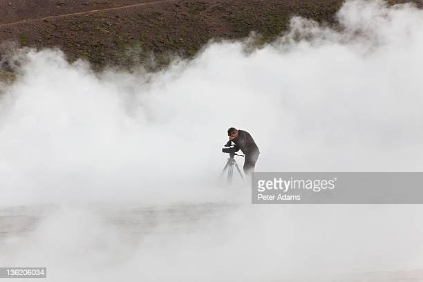 videographer filming at geothermal pools, iceland - film crew stock pictures, royalty-free photos & images