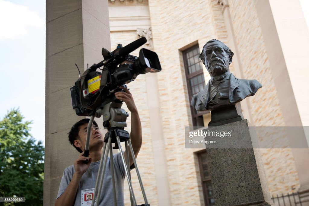 A videographer films a bust of Robert E. Lee as it stands in the 'Hall of Fame for Great Americans' on the campus of Bronx Community College, August 17, 2017 in the Bronx borough of New York City. On Wednesday night, the school announced the statues of Robert E. Lee and Confederate general Stonewall Jackson will be replaced and removed.