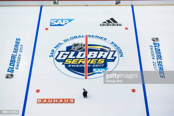 Videographer is seen on the ice during the rink build out ahead of the SAP NHL Global Series between Ottawa Senators and Colorado Avalanche at...
