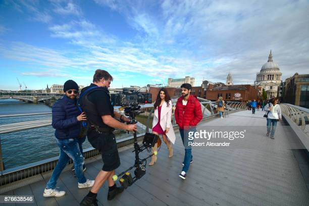 Videographer Mike Scott shoots a scene for the fourth installment of the Bollywood 'Hate Story' film series on Millennium Bridge in London, England....