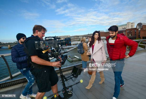 Videographer Mike Scott shoots a scene for the fourth installment of the Bollywood 'Hate Story' film series on Millennium Bridge in London England...