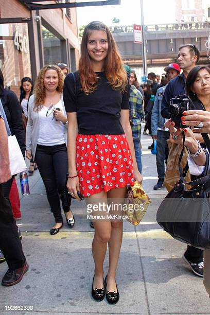 Videographer Rebecca Fourteau seen wearing a Vivian Westwood sweater Topshop skirt Charlotte Olympia shoes and Jeremy Scott bag outside the Jeremy...
