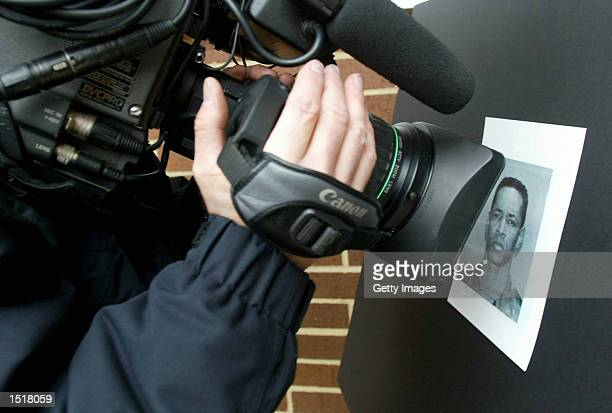 A videographer shoots footage of a photograph of sniper suspect John Allen Muhammad also known as John Allen Williams at Montgomery County Police...