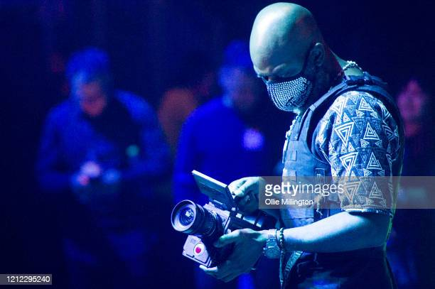 A videographer wearing a face mask films Blu Cantrell as she performs onstage during Kisstory The Blast Off Tour at The O2 Arena on March 11 2020 in...
