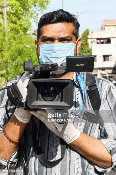 ANI videojournalist Pankaj Sharma poses for a photo as he covers news event during a governmentimposed nationwide lockdown as a preventive measure...
