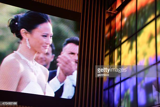 videos on wall, transmitting movies and psychedelic images, hong kong - actress stock pictures, royalty-free photos & images