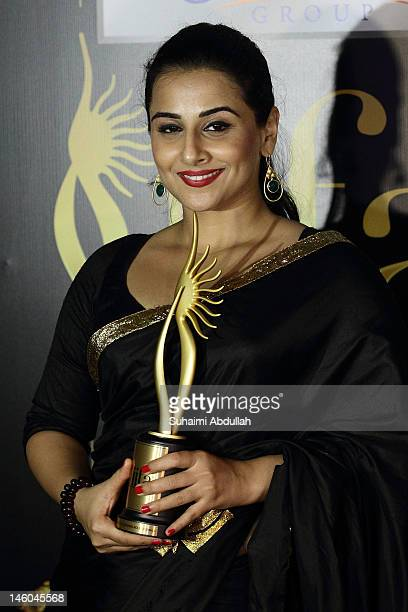 Vidya Balan poses for a photo backstage after she wins the award for Best Actress for her role in The Dirty Picture at the 2012 International India...