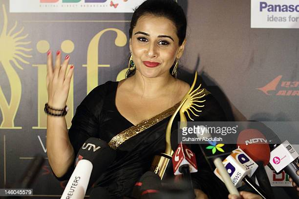 Vidya Balan speaks to the media backstage after she wins the Best Actress award for her role in The Dirty Picture at the 2012 International India...