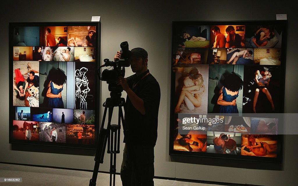 A viedographer films works by American photographer Nan Goldin prior to the opening of the 'Poste Restante' exhibition of her work at the C/O Gallery on October 9, 2009 in Berlin, Germany. The exhibition will be open to the public from October 10 until December 6, 2009.