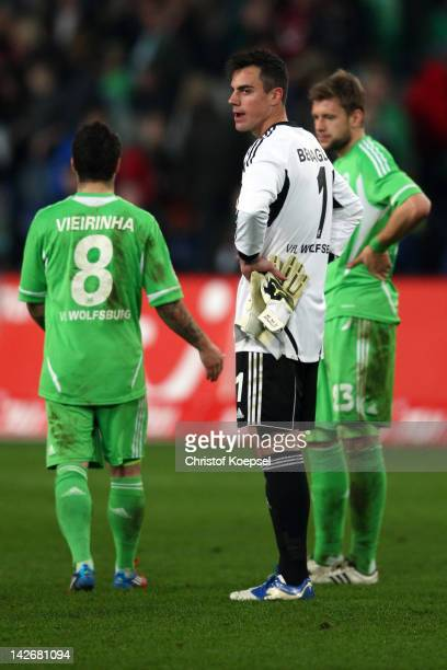 Vieirinha Diego Benaglio and Marco Russ of Wolfsburg look dejected after losing 02 the Bundesliga match between Hanover 96 and VfL Wolfsburg at AWD...