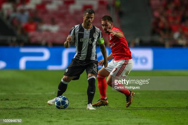 Vieirinha of PAOK vies with Andrija Zivkovic of SL Benfica for the ball possession during the match between SL Benfica and PAOK for the UEFA...