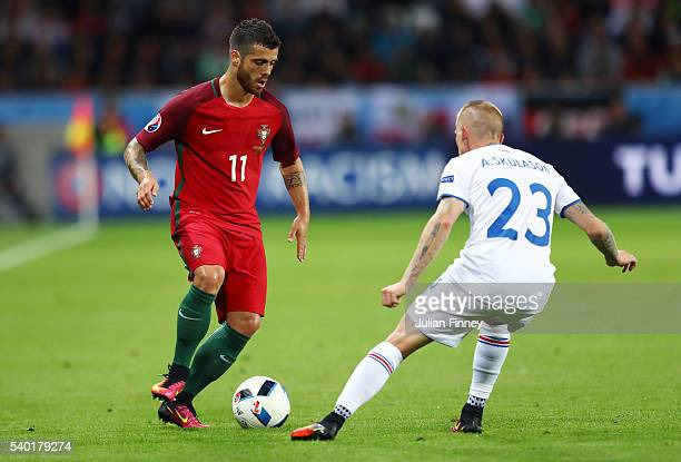 Vieirinha of Portugal and Ari Skulason of Iceland compete for the ball during the UEFA EURO 2016 Group F match between Portugal and Iceland at Stade...
