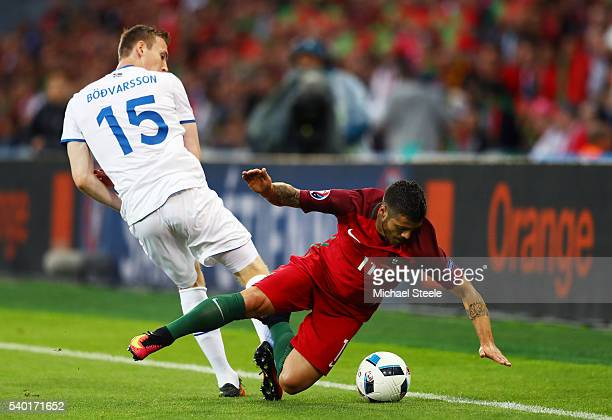 Vieirinha of Portugal and Jon Dadi Bodvarsson of Iceland compete for the ball during the UEFA EURO 2016 Group F match between Portugal and Iceland at...