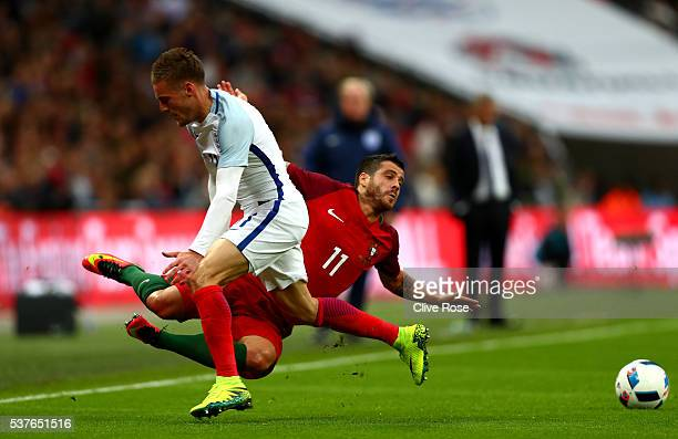 Vieirinha of Portugal is challenged by Jamie Vardy of England during the international friendly match between England and Portugal at Wembley Stadium...