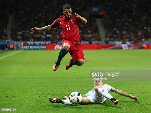 Vieirinha of Portugal is tackled by Ari Skulason of Iceland during the UEFA EURO 2016 Group F match between Portugal and Iceland at Stade...