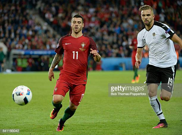 Vieirinha of Portugal with Lukas Hinterseer of Austria during the UEFA EURO 2016 Group F match between Portugal and Austria at Parc des Princes on...