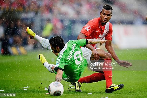 Vieirinha of VfL Wolfsburg is challenged by Eric Maxim Choupo-Moting of 1. FSV Mainz 05 during the Bundesliga match between 1. FSV Mainz 05 and VfL...