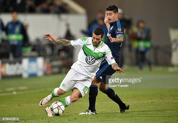 Vieirinha of Wolfsburg and James Rodriguez of Real Madrid compete for the ball during the UEFA Champions League Quarter Final First Leg match between...