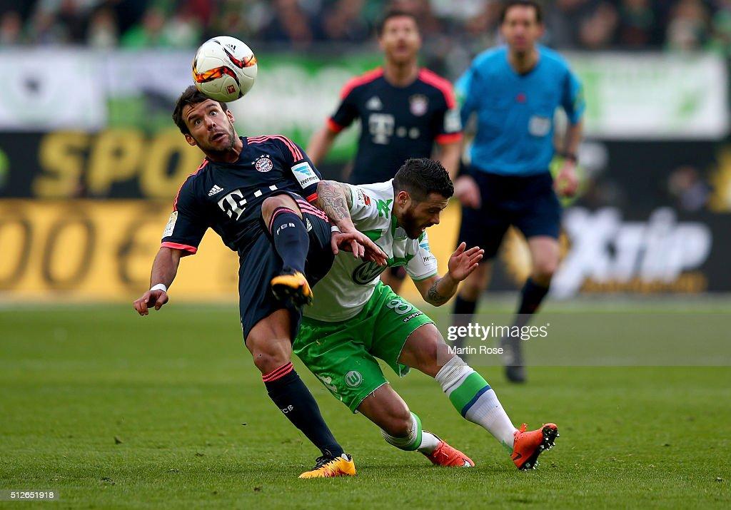 Vieirinha #8 of Wolfsburg and Juan Bernat of Muenchen battle for the ball during the Bundesliga match between VfL Wolfsburg and FC Bayern Muenchen at Volkswagen Arena on February 27, 2016 in Wolfsburg, Germany.
