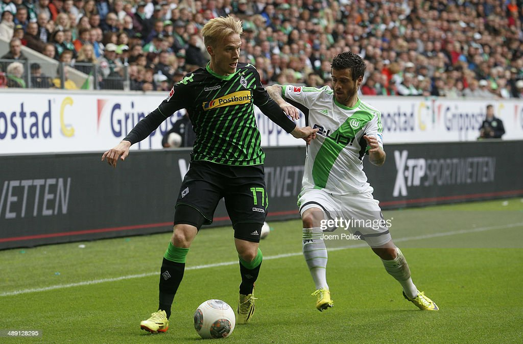 Vieirinha (R) of Wolfsburg and Julian Korb of Moenchengladbach compete for the ball during the Bundesliga match between at Volkswagen Arena on May 10, 2014 in Wolfsburg, Germany.