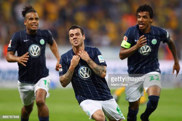 Vieirinha of Wolfsburg celebrates his team's first goal with team mates Daniel Didavi and Luiz Gustavo during the Bundesliga Playoff leg 2 match...