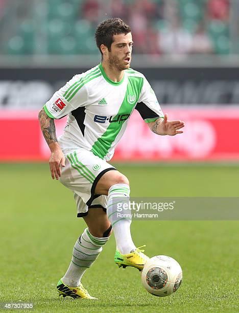 Vieirinha of Wolfsburg runs with the ball during the Bundesliga match between VfL Wolfsburg and SC Freiburg at Volkswagen Arena on April 26 2014 in...