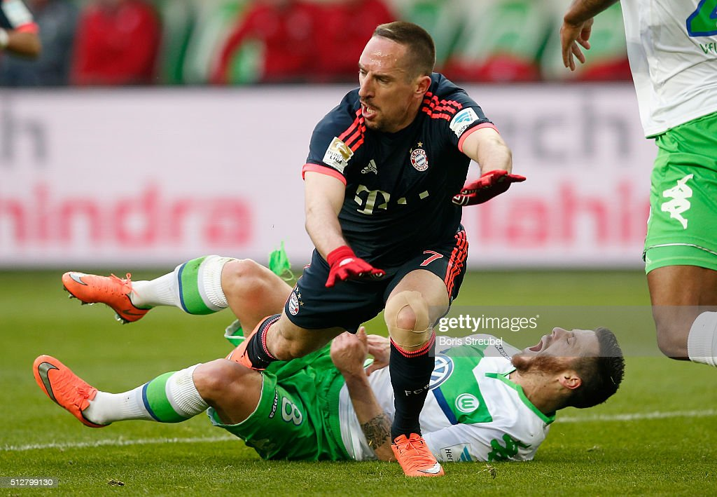 Vieirinha of Wolfsburg takes an injury after Franck Ribery of Muenchen falls over him during the Bundesliga match between VfL Wolfsburg and FC Bayern Muenchen at Volkswagen Arena on February 27, 2016 in Wolfsburg, Germany.