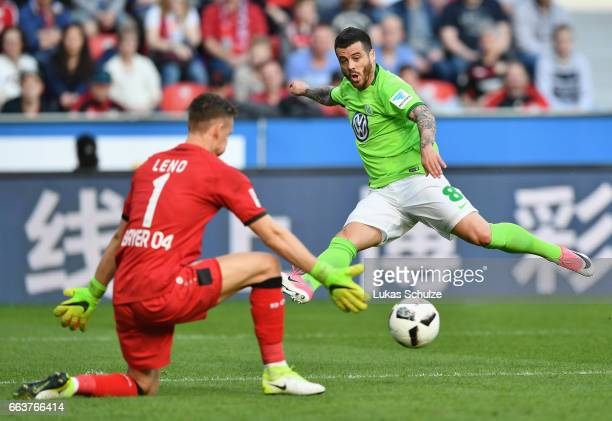 Vieirinha of Wolfsburg trys to shoot past Bernd Leno of Leverkusen during the Bundesliga match between Bayer 04 Leverkusen and VfL Wolfsburg at...