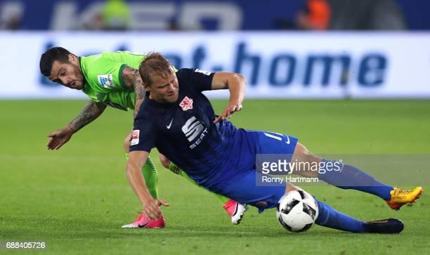 Vieirinha of Wolfsburg vies with Jan Hochscheidt of Braunschweig during the Bundesliga Playoff first leg match between VfL Wolfsburg and Eintracht...