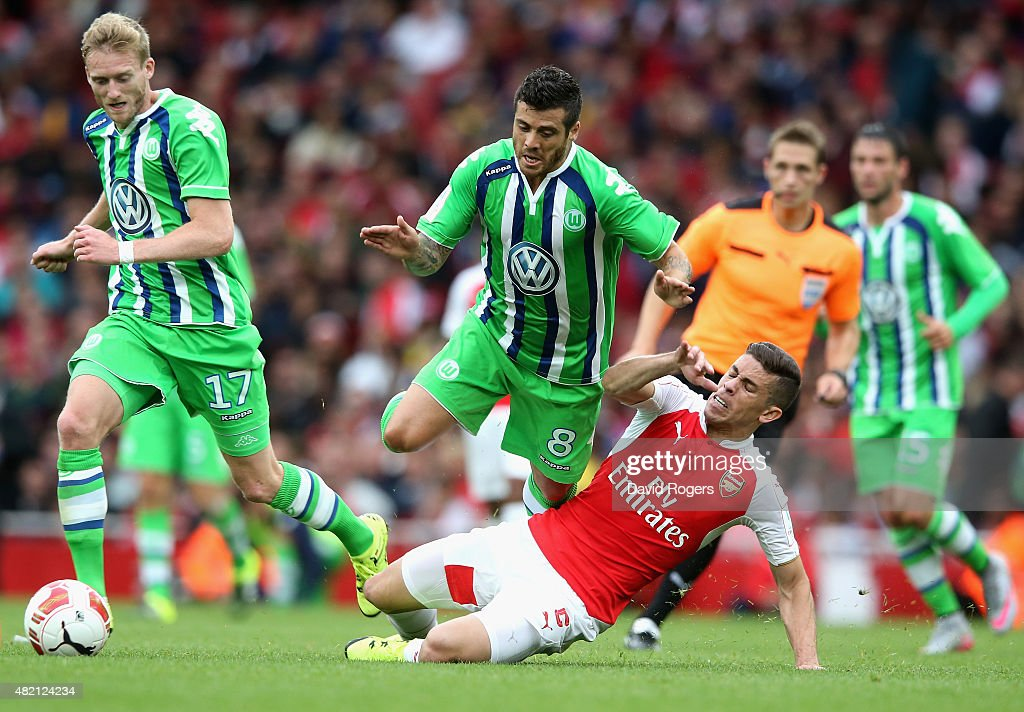 Vieirnha of Wolfsburg is tackled by Gabriel during the Emirates Cup match between Arsenal and VfL Wolfsburg at the Emirates Stadium on July 26, 2015 in London, England.
