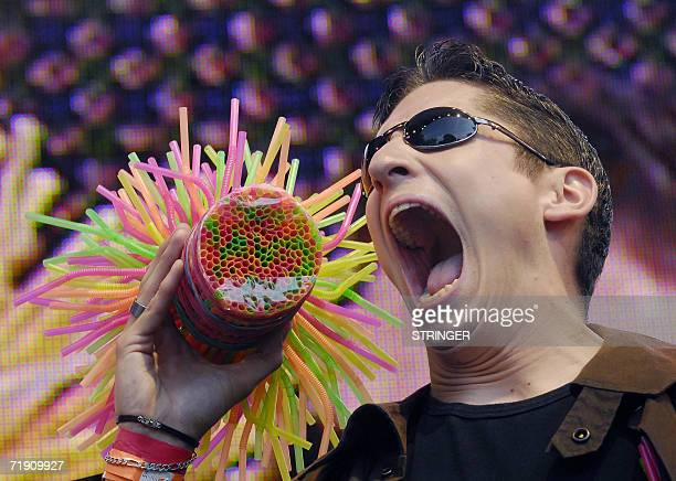 Austrian Marco Hort takes in mouth 259 drinking straws during the World Records day at Vienna's Prater, 17 September 2006. AFP PHOTO/Vladimir Kmet