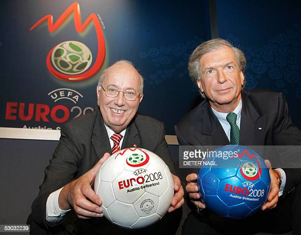 Austrian soccer Federation President Rudolf Stickler and his Swiss counterpart Ralph Zloczower pose with the official logo for the UEFA 2008 soccer...