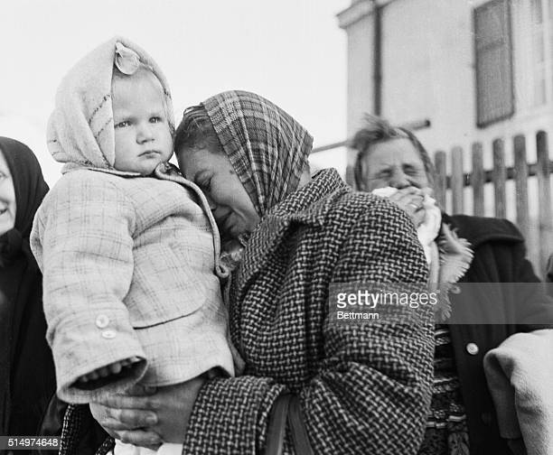 Exodus1956 A refugee mother cries into the shoulder of her child after reaching safety in Austria The woman knew nothing of her husband who had...