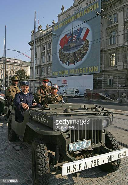 Four men impersonating WW2 Allied US Russian British and French soldiers and policeman pose for photographer 02 September 2005 in a jeep in Vienna...