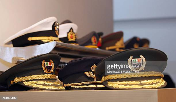 Military caps are seen at an Organization for Security and Cooperation in Europe seminar on military doctrine at the Hofburg in Vienna 14 February...