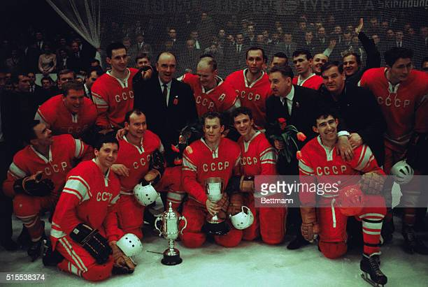 Soviet ice hockey team with trophy after winning the Worlds Amateur Championships.