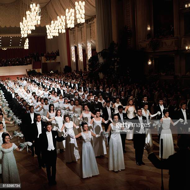 Vienna, Austria: the Vienna Statsoper, , held an Opera Ball at which debutantes were presented. White clad debutantes and their escorts open the ball.