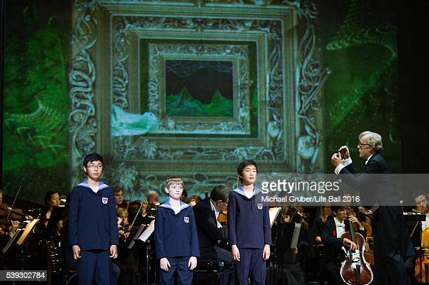 Vienna Boys' Choir conducted by Martin Haselboeck perform on stage during the Red Ribbon Celebration Concert at Burgtheater on June 10 2016 in Vienna...